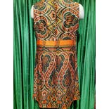 another view of 60's/70's Orange and Green Psychedelic Pattern Dress by Mary Martin