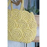 another view of 60's Buttercream Yellow Raffia Woven Scalloped Circle Pattern Handbag