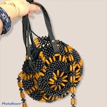 another view of Black and Golden Brown Beaded Round Crossbody Bag by Straw Studios