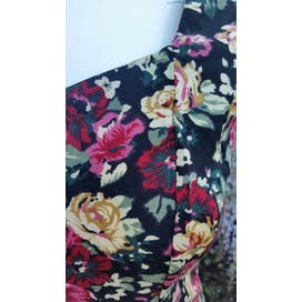 Black Sleeveless Dress with Red and Gold Floral Print and Crisscross Back by All that jazz