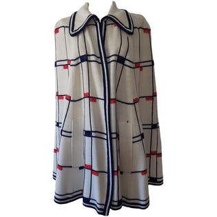 White Knit Cape with Blue and Red Mondrian Style Print by Broadway